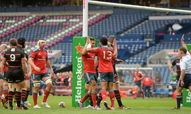 Casey Laulala of Munster is congratulated by team-mate Conor Murray on scoring a try against Edinburgh.