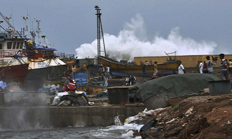 A huge wave driven by Cyclone Phailin comes ashore  at Vishakhapatnam in India's eastern state of An