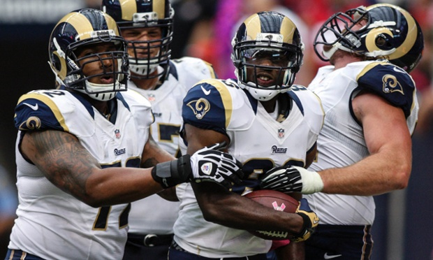St. Louis Rams wide receiver Brian Quick celebrates his touchdown reception against the Houston Texans with team-mates.