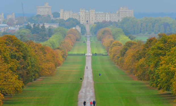 Walkers Enjoy The Autumn Colours Along Great Walk In Windsor Park With Queen Elizabeths Home Castle Seen Behind