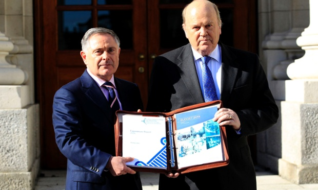 Minister for Public Expenditure and Reform Brendan Howlin (left) and Minister for Finance Michael Noonan deliver the 2014 Budget at Government Buildings, Dublin.