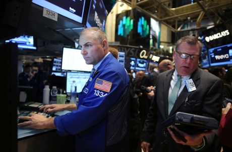 Traders work on the floor of the New York Stock Exchange on October 16, 2013 in New York City