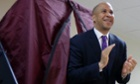 Newark Mayor Cory Booker walks out of a polling booth for the vacant New Jersey seat in the US Senate.