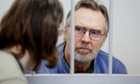 Photo released by Greenpeace shows Colin Russell behind bars during a bail hearing in Murmansk.