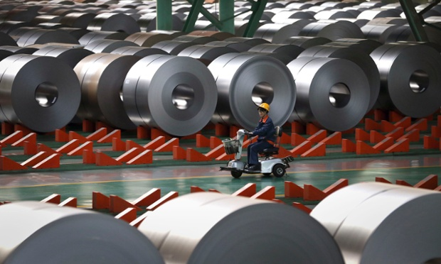 An employee works inside a steel factory in Caofeidian on the northeastern coast of China's Hebei province, October 11, 2013.