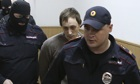Bolshoi Theatre dancer Pavel Dmitrichenko is escorted to a court session on Monday 16 October