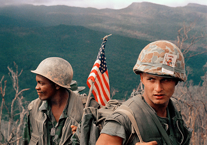 Marines move through a landing zone, December 1969 ~ Photograph: AP