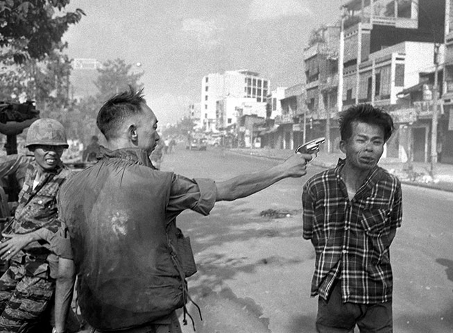 General Nguyen Ngoc Loan, South Vietnamese chief of the national police, fires his pistol into the head of suspected Viet Cong official Nguyen Van Lem on a Saigon street early in the Tet offensive on 1 February 1968. Photographer Eddie Adams reported that after the shooting, Loan approached him and said 'They killed many of my people, and yours too,' then walked away. This photo won the 1969 Pulitzer prize for spot news photography ~ Photograph: Eddie Adams/AP