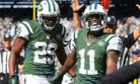Jeremy Kerley (right) celebrates his touchdown catch during the New York Jets' win over the New England Patriots.