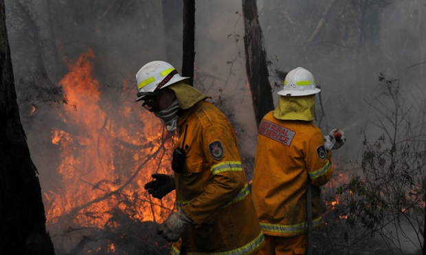 New South Wales (NSW) Rural Fire Service crews protect a property on Bulgamatta Road in the township of Berambing in the Blue Mountains, west of Sydney, Australia, 22 October 2013