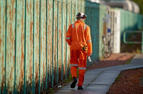 A worker from Grangemouth chemical plant makes his way from a staff meeting on October 23, 2013 in Grangemouth, Scotland.