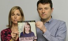 Kate and Gerry McCann hold up a picture of Madeleine