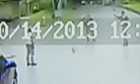 This image from video shows Bobby Gerald Bennett, left, standing as two Dallas Police officers approach him.