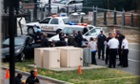 A black sedan car believed to be the subject of a police chase that ended in gunfire at the US Capitol.   (AP Photo/ Evan Vucci)