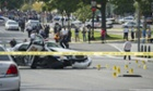 A police cruiser is wrecked after shots were reported near 2nd Street NW and Constitution Avenue in Washington.