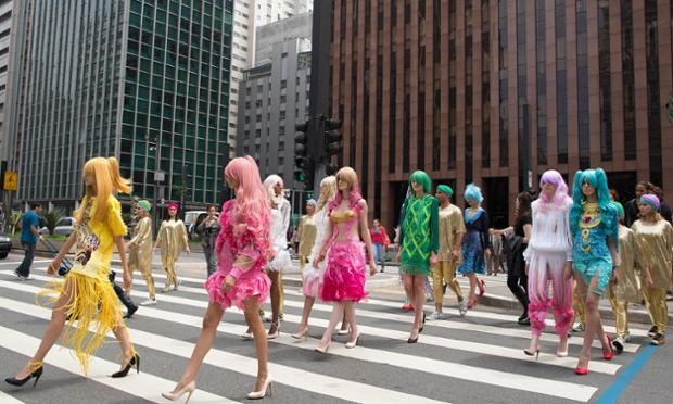 Using the streets of the Sao Paulo financial district as a catwalk, models present designs from Fause Haten winter collection, as part of Fashion Week in Brazil.