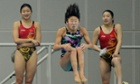 A Japanese diver practices beside two Chinese divers before competing in the Women's synchronized 3m springboard final at the East Asian Games held at the Tianjin Olympic Centre, China.