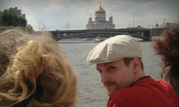 A man, thought to be Edward Snowden, is seen in front of the Christ the Saviour Cathedral