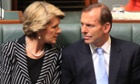Tony Abbott talks to foreign affairs minister Julie Bishop during the opening parliament on Tuesday.
