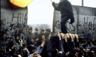 West Berliners break down a section of the Berlin Wall