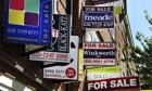 For-sale signs on a property in east London