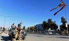 Afghan policeman look on in Kabul.