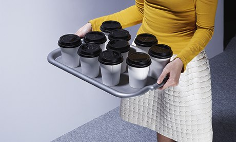 A woman carrying a tray of tea