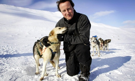 David Cameron with a husky dog on his visit to the Arctic as opposition leader.