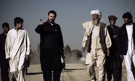 Jeremy Scahill (centre, in black) in a scene from Dirty Wars