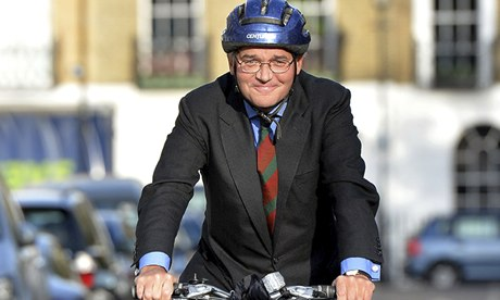 Former chief whip Andrew Mitchell rides his bicycle