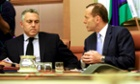 Prime Minister Tony Abbott speaks to federal treasurer Joe Hockey at a meeting of attendees to the 2014 G20 meeting in Brisbane. (