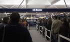 People queuing at immigration UK border, Stansted airport, London, England, Europe.