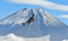 Yves Rossy, known as the Jetman, flies by Mount Fuji in Japan.