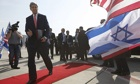 John Kerry walks to his plane after a private meeting with Israeli PM Binyamin Netanyahu in Tel Aviv