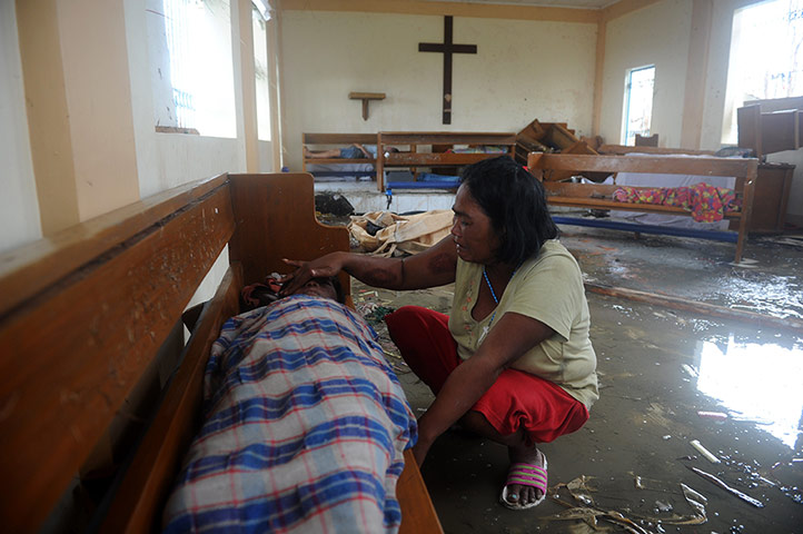 Typhoon Aftermath: A mother weeps beside her son's body