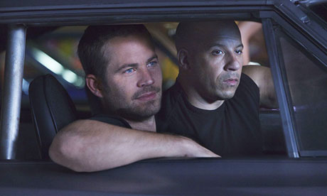Paul Walker, shown with co-star Vin Diesel in Fast & Furious 5, has died in a car crash