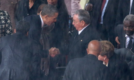 Barack Obama shakes hands with Cuban President Raul Castro during the memorial service for Nelson Mandela in Johannesburg, South Africa.