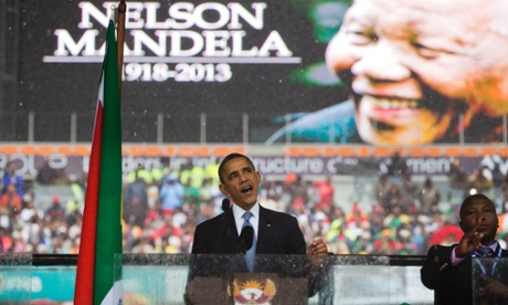 President Barack Obama speaks to crowds attending the memorial service for former South African president Nelson Mandela.