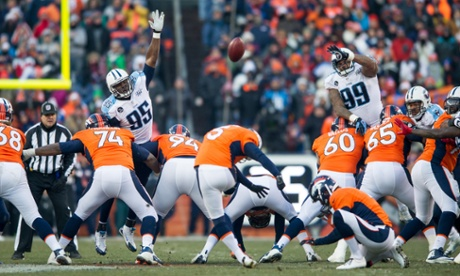 Matt Prater of the Broncos kicks a record-setting 64-yard field goal against the Tennessee Titans at Sports Authority Field Field at Mile High on December 8, 2013 in Denver, Colorado
