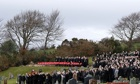 Mourners by the graveside of Tony Collins