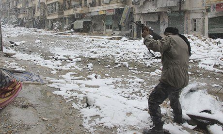 A Syrian rebel fighter aims his weapon at pro-government forces in Aleppo