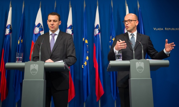 Slovenian Finance Minister Uros Cufer (L) and Bank of Slovenia governor Bostjan Jazbec hold a press conference to present the results of bank stress tests in Ljubljana on December 12, 2013.
