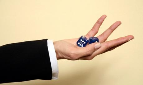 women hand dice risk