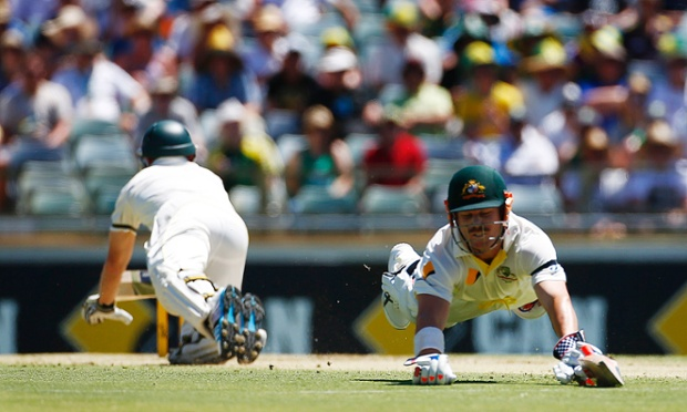 Chris Rogers and David Warner dive for their ground, but Rogers is run out.