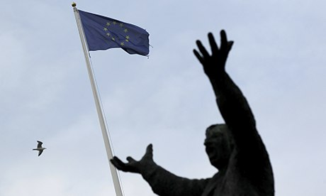Ireland becomes first country to exit eurozone bailout programme EU-flag-behind-statue-of--008