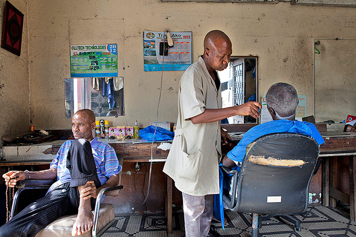 big picture - barbers: men in barber shop in Africa