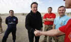 David Cameron and Michael Owen meet troops