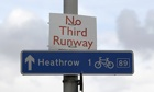 No third runway protest above Heathrow sign