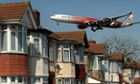An Etihad Airways passenger jet flies over houses as it prepares to land at Heathrow Airport. Heathrow expansion is going to feature in the Airports Commission's interim report.
