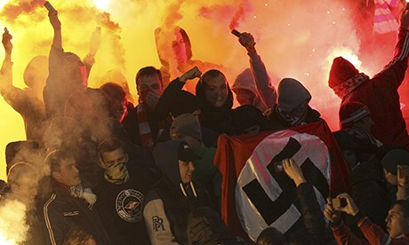 Spartak Moscow fans displaying a Nazi flag
